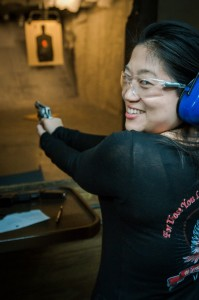 naoma shooting a revolver